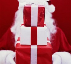 For those who do not know, Secret Santa is where you draw a name at random from a group of people and buy them a gift. However no body knows who you've gotten until the day everyone exchanges gifts!   Image source:  (www.mikespokerleague.com)