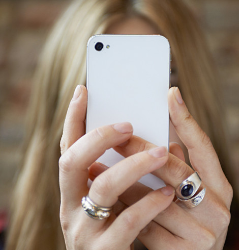 woman taking selfie with cell phone