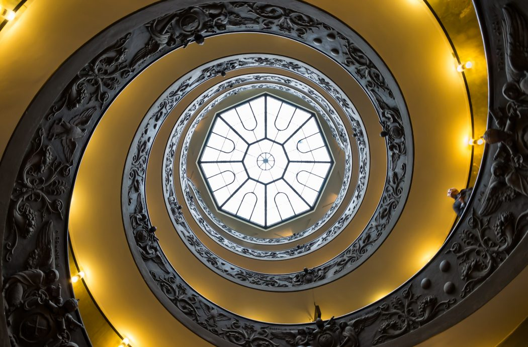 Looking up from the bottom of the spiral staircase by Giuseppe Momo . Vatican Museums.