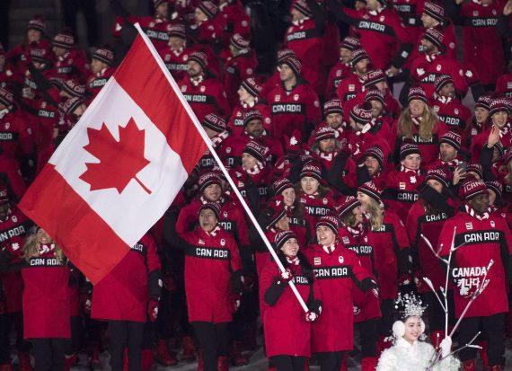 Tessa Virtue Scott Moir selected as Canadas flag bearers